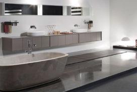 Stenbadkar i massiv brun marmor och badrumsskåp från antonio lupi