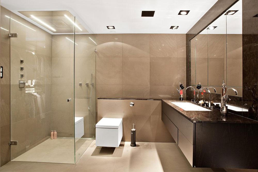 Badrum med brun granit som badrumsbänk och beige kvartsit på golv och väggar