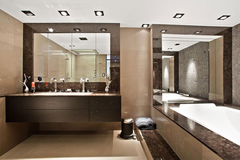 Badrumsbänk och badkarsavtäckning i granit och golv samt vägg i beige kvartsit
